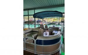 Covered boat with round sitting area in front