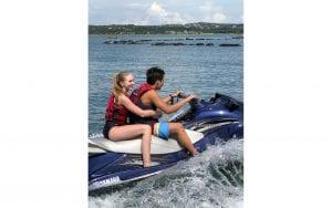 Guy and girl jetskiing