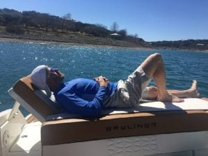 laying on the back of a boat sunning