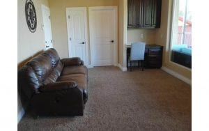Lake house rental room with couch and desk